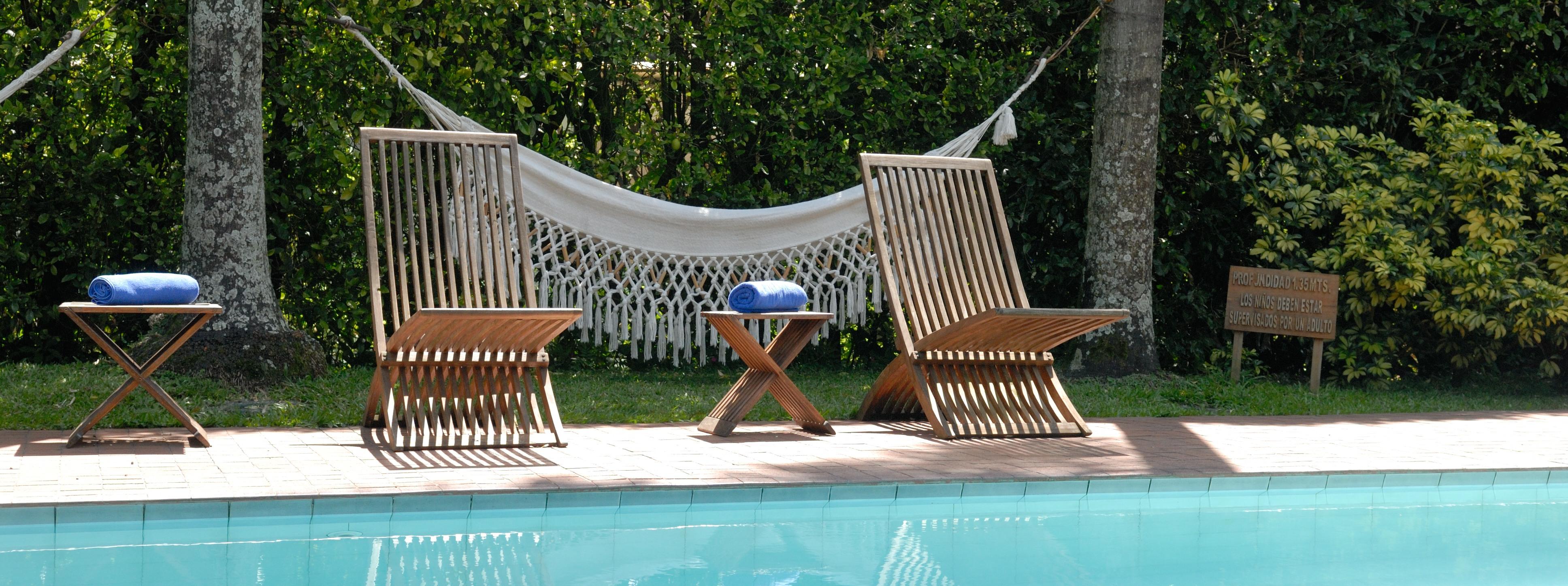 http://www.kontour-travel.com/wp-content/uploads/pool-hammock.jpg